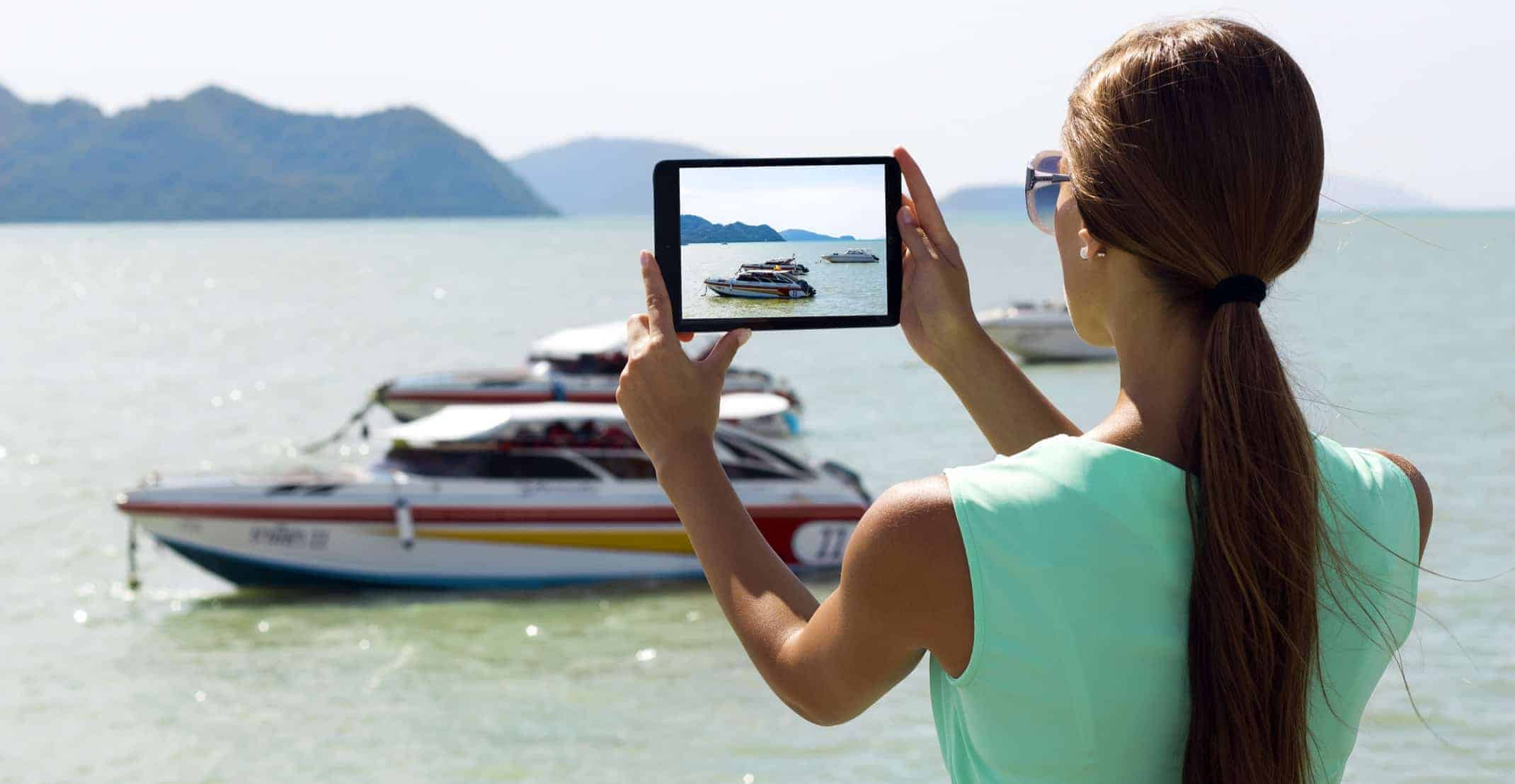 Woman Taking Pictures with a Tablet