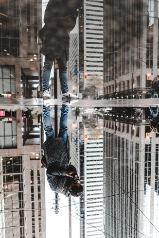 Forced perspective photography of a skyscraper reflection