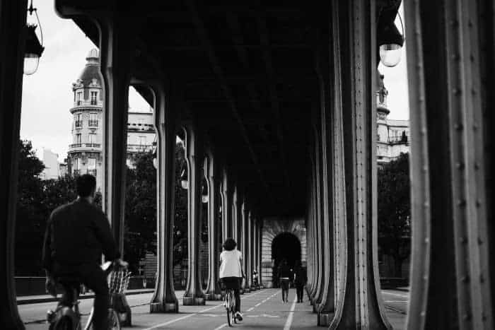 People riding bikes on Bir Hakeim Bridge, Paris