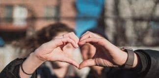 Couple creating a Hand Heart / Matt Nelson on Unsplash
