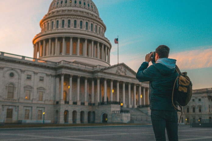 A photographer at the US Capitol Building in Washington DC